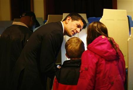 Republican vice presidential candidate Paul Ryan and his wife Janna vote during the U.S. Presidential election accompanied by their children Charlie, Sam and Liza in Janesville, Wisconsin November 6, 2012. REUTERS/Eric Thayer