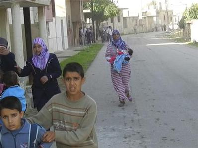 Residents flee their homes after a shelling by forces loyal to Syria's President Bashar al-Assad at Houla, near Homs, November 6, 2012. REUTERS/Misra Al-Misri/Shaam News Network/Handout