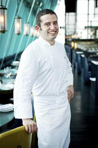 Italian chef Giuliano Dacasto poses at Aqua Roma restaurant in Hong Kong in this undated handout photo. Dacasto has done much traveling to perfect his cuisine, moving from the three Michelin-starred Le Calandre to Gordon Ramsay's The Boxwood Cafe and 2 Venti in London. But it was right in his family kitchen in Turin, Italy that he first learned all the tricks of the trade - and it is in Hong Kong where he plans to showcase his innovative Italian cuisine in a city with one of the densest clusters of Michelin-starred restaurants in the world. REUTERS/Aqua Restaurant Group Handout