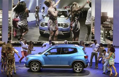 Models perform during the presentation of Volkswagen Taigun at the International Sao Paulo Motor Show media day in Sao Paulo October 22, 2012. REUTERS/Paulo Whitaker