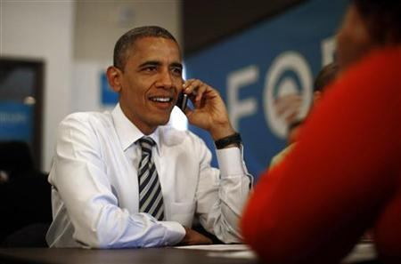 U.S. President Barack Obama makes a phone call to a volunteer as he visits a campaign field office in Chicago, on election day November 6, 2012. REUTERS/Jason Reed