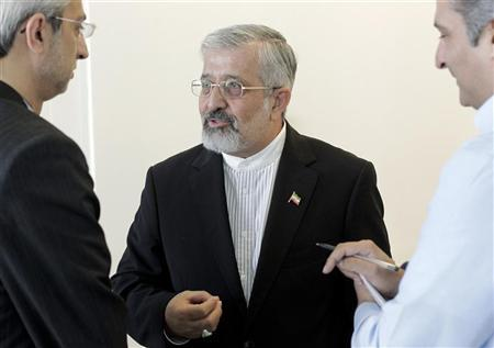 Iran's International Atomic Energy Agency (IAEA) ambassador Ali Asghar Soltanieh talks to people as he attends a board of governors meeting at the United Nations headquarters in Vienna September 10, 2012. REUTERS/Herwig Prammer