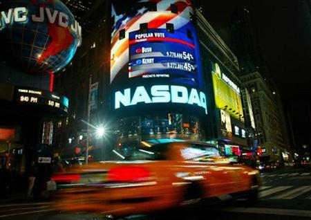 Early projections in the United States presidential election by CNN are projected on the NASDAQ screen in New York's Time Square November 2, 2004. REUTERS/Shannon Stapleton US ELECTION