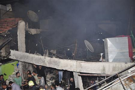 A crowd gathers at the site of an explosion in Hai al-Wuroud, near Damascus November 6, 2012, in this handout photograph released by Syria's national news agency SANA. REUTERS/SANA/Handout