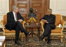 India's President Pranab Mukherjee (R) speaks with Canadian Prime Minister Stephen Harper during their meeting at India's presidential palace Rashtrapati Bhavan in New Delhi November 6, 2012. Harper is on a six-day state visit to India. REUTERS/India's Presidential Palace/Handout