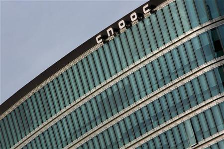 A logo of China National Offshore Oil Corp (CNOOC) is seen on the top of its headquarters in Beijing November 1, 2010. REUTERS/Petar Kujundzic