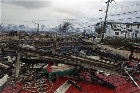 Homes that are devastated by fire and the effects of Hurricane Sandy are seen at the Breezy Point section of the Queens borough of New York in this October 30, 2012, file photo. REUTERS/Shannon Stapleton/Files