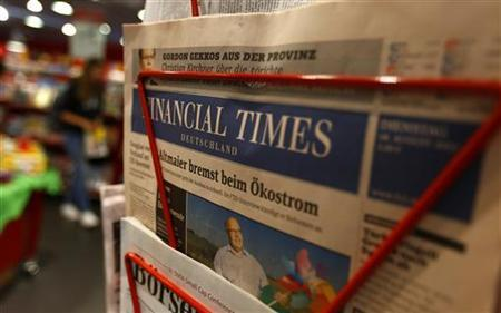 An edition of the Financial Times Deutschland (Germany) is seen at a shop in Frankfurt August 28, 2012. REUTERS/Kai Pfaffenbach/Files