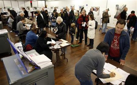 People line up to vote in the U.S. presidential election at a polling station set up for those affected by Hurricane Sandy in an art gallery at John Jay College in New York November 6, 2012. REUTERS/Chip East
