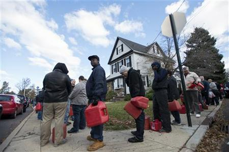 Residents line up for gasoline at a temporary fueling station at the National Guard armory in the Staten Island Borough of New York, November 3, 2012 in the aftermath of Hurricane Sandy. REUTERS/Keith Bedford