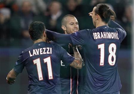 Paris St Germain's Jeremy Menez (C) celebrates with teammates Ezequiel Lavezzi and Zlatan Ibrahimovic after he scored the third goal for the team during their Champions League soccer match against Dinamo Zagreb at Parc des Princes stadium in Paris, November 6, 2012. REUTERS/Cedric Lecocq