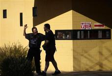 A voter puts his hands in the air after leaving a polling station outside Hayden Park during the U.S. presidential election in Phoenix, Arizona November 6, 2012. REUTERS/Joshua Lott