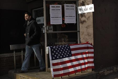 A man leaves a relocated polling station after casting his ballot in the U.S. presidential election at a polling station set up for those affected by Hurricane Sandy in Hoboken, New Jersey November 6, 2012. REUTERS/Eduardo Munoz