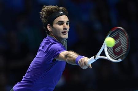 Switzerland's Roger Federer hits a return to Serbia's Janko Tipsarevic during their men's singles tennis match at the ATP World Tour Finals in the O2 Arena in London November 6, 2012.REUTERS/Dylan Martinez