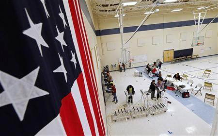 Voters cast ballots at a polling station at Freedom Academy in the U.S. presidential election in Provo, Utah, November 6, 2012. REUTERS/George Frey