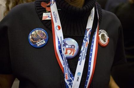 A woman displays badges in support of the Democratic candidate, U.S. Preseidnt Barack Obama during an election party, during the U.S. Presidential election, at the U.S. Embassy in London, November 6, 2012. REUTERS/Neil Hall