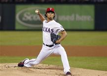 Texas Rangers pitcher Yu Darvish throws against the Baltimore Orioles in the first inning of their MLB American League Wild Card playoff baseball game in Arlington, Texas October 5, 2012. REUTERS/Tim Sharp