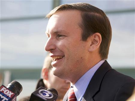 Three-term Democratic Representative and U.S. Senatorial candidate Chris Murphy addresses the members of the media at a polling place on election day in Cheshire, Connecticut, November 6, 2012. REUTERS/Michelle McLoughlin