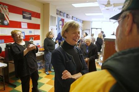 Democratic candidate Congresswoman Tammy Baldwin (C), who is running US Senate seat, meets with supporters at the North Shore Obama for America office in Glendale, Wisconsin, October 31, 2012. REUTERS/Darren Hauck