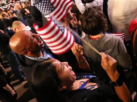 Attendees celebrate during U.S. President Barack Obama's election night rally in Chicago, November 6, 2012. REUTERS/Philip Scottr- Andrews