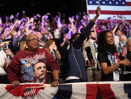 Attendees celebrate during U.S. President Barack Obama's election night rally in Chicago, November 6, 2012. REUTERS/Philip Andrews