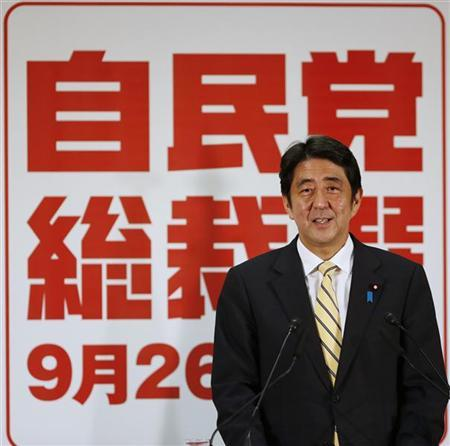 Newly elected Japan's main opposition Liberal Democratic Party (LDP) President Shinzo Abe smiles during a news conference at the LDP headquarters in Tokyo September 26, 2012. REUTERS/Toru Hanai
