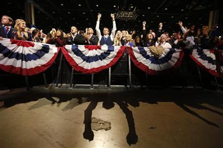 Supporters of U.S. President Barack Obama cheer during his election night victory rally in Chicago, November 6, 2012. REUTERS/Kevin Lamarque