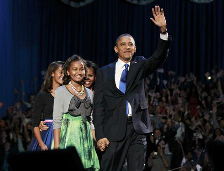U.S. President Barack Obama and his family walk onstage during his election night victory rally in Chicago, November 6, 2012. (L-R) Daughters Malia, Sasha, First lady Michelle Obama and the President. REUTERS/Jason Reed