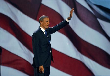 U.S. President Barack Obama, who won a second term in office by defeating Republican presidential nominee Mitt Romney, waves as he addresses supporters during his election night victory rally in Chicago, November 7, 2012. REUTERS/Jim Bourg