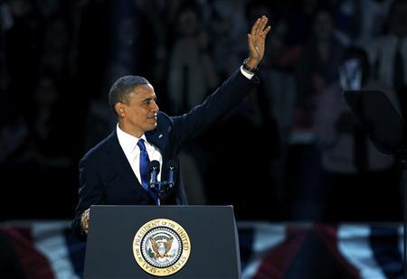 U.S. President Barack Obama, who won a second term in office by defeating Republican presidential nominee Mitt Romney, waves before addressing supporters during his election night victory rally in Chicago, November 7, 2012. REUTERS/Jeff Haynes