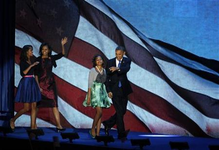 U.S. President Barack Obama, who won a second term in office by defeating Republican presidential nominee Mitt Romney, walks out with his family to address supporters during his election night rally in Chicago, November 7, 2012. REUTERS/Jeff Haynes