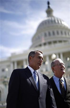 U.S. House Speaker John Boehner (L)(R-OH) walks with Senator Lamar Alexander (R-TN) from a ceremony for the Presidential Inauguration on the west front of the U.S. Capitol in Washington, September 20, 2012. REUTERS/Jason Reed