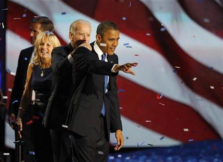 U.S. President Barack Obama (R) celebrates with Vice President Joe Biden, Dr. Jill Biden and their son Beau (L) at their election night victory rally in Chicago, November 7, 2012. REUTERS/Jim Bourg