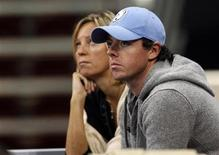 Golfer Rory McIlroy watches from the stands the WTA Tournament of Champions final match between Caroline Wozniacki of Denmark and Nadia Petrova of Russia in Sofia November 4, 2012. REUTERS/Stoyan Nenov