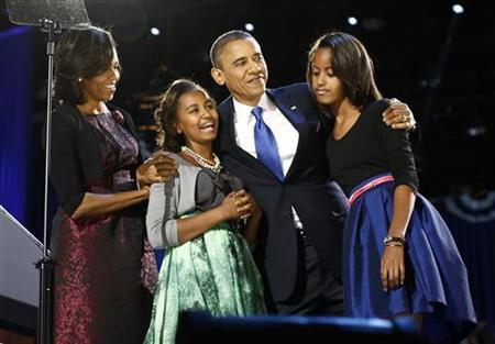 U.S. President Barack Obama celebrates with first lady Michelle Obama and their daughters Malia (R) and Sasha at their election night victory rally in Chicago, November 7, 2012. REUTERS/Jason Reed