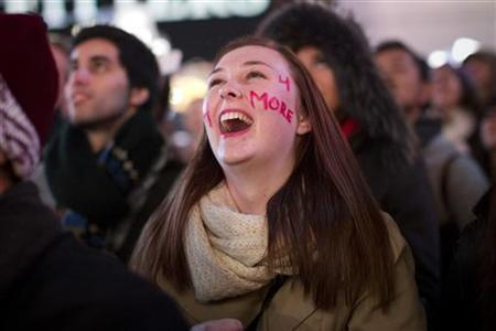 People celebrate as they watch U.S. President Barack Obama's acceptance speech broadcast live in Times Square following his re-election in New York November 7, 2012. REUTERS/Andrew Kelly
