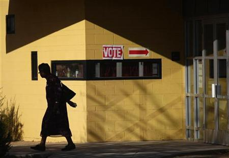 A voter leaves polling station outside Hayden Park during the U.S. presidential election in Phoenix, Arizona November 6, 2012. REUTERS/Joshua Lott