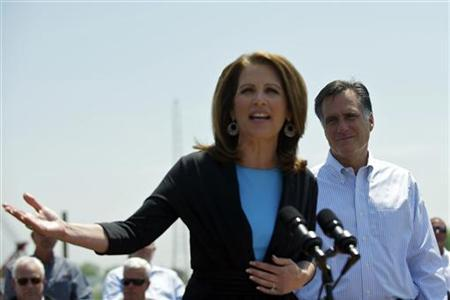 Congressman Michele Bachmann speaks next to U.S. Republican presidential candidate and former Massachusetts Governor Mitt Romney during a rally at Crofton Industries in Portsmouth, Virginia May 3, 2012. REUTERS/Mark Makela