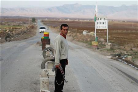 A Syrian Kurd Asaish stands at a security checkpoint at Derik in Al-Hasakah October 31, 2012. Picture taken October 31, 2012. REUTERS/Thaier al-Sudani