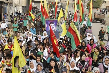Syrian Kurds demonstrators hold flags and portraits of jailed Kurdistan Workers Party (PKK) leader Abdullah Ocalan during a protest in Derik, Hasakah November 1, 2012. REUTERS/Thaier al-Sudani
