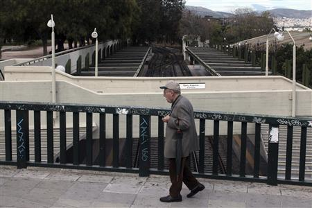 A man walks through an empty train station in Athens November 7, 2012 during a 48-hour strike by the two major Greek workers unions. Greece's ruling coalition hopes to overcome its own divisions and defy protestors on Wednesday to push through an austerity package needed to secure aid and avert bankruptcy. REUTERS/Costas Baltas