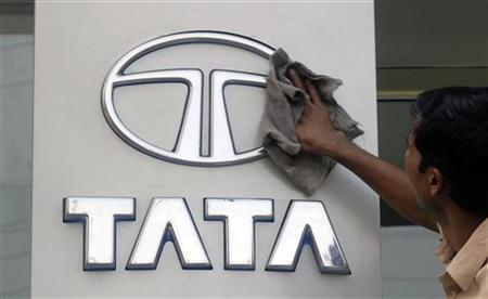 A worker cleans a Tata Motors logo outside its showroom in Hyderabad October 26, 2009. REUTERS/Krishnendu Halder/Files