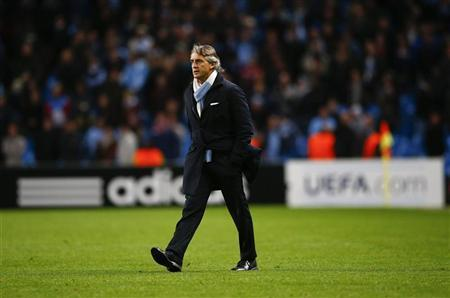 Manchester City's coach Roberto Mancini walks on the pitch to speak with officials after their Champions League Group D soccer match against Ajax Amsterdam at The Etihad Stadium in Manchester, northern England, November 6, 2012. REUTERS/Darren Staples