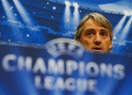 Manchester City's manager Roberto Mancini speaks during a news conference in Amsterdam Arena stadium October 23, 2012. REUTERS/Robin van Lonkhuijsen/United Photos