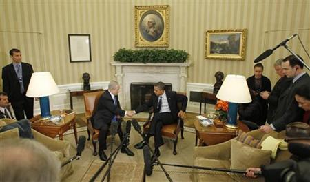 U.S. President Barack Obama shakes hands with Israel's Prime Minister Benjamin Netanyahu during their meeting in the Oval Office of the White House in Washington, March 5, 2012. REUTERS/Jason Reed