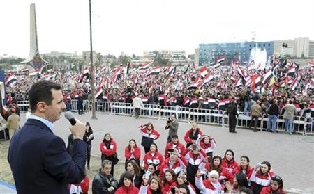 Syria's President Bashar al-Assad addresses his supporters during a surprise appearance at a rally in Umayyad Square in Damascus January 11, 2012.REUTERS/Wael Hmedan-Presidential Palace/Files
