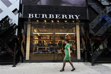 A woman walks past a Burberry shop in Beijing, July 11, 2012. REUTERS/Jason Lee