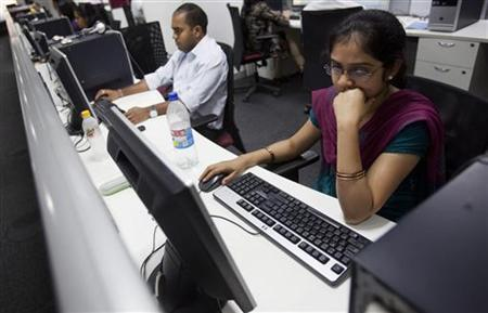 Employees work on their computer terminals on the floor of an outsourcing centre in Bangalore February 29, 2012. REUTERS/Vivek Prakash