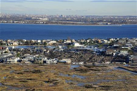 An aerial view of Hurricane Sandy damage along the coast of New York from a Georgia Army National Guard CH-47 Chinook heavy-lift helicopter during a flight from Joint Base McGuire-Dix-Lakehurst, New Jersey, November 3, 2012 in this U.S. Air Force handout photo. Picture taken November 3, 2012. REUTERS/U.S. Air Force/Tech. Sgt. Parker Gyokeres/Handout