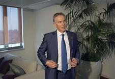 Middle East envoy Tony Blair stands after an interview with Reuters in Jerusalem November 7, 2012. President Barack Obama's election victory opens the way for renewed efforts to revive moribund peace negotiations between Israel and the Palestinians, Blair said on Wednesday. REUTERS/Ronen Zvulun